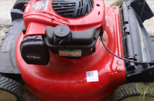 Steps To Clean Your Lawn Mower Carburetor: Unbolt the bowl and clean it